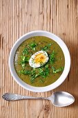 Sorrel soup with a hard boiled egg