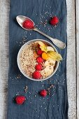 A cacao smoothie bowl with raspberries, banana and popped amaranth