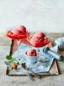 Strawberry yoghurt ice cream in a strawberry wine sauce