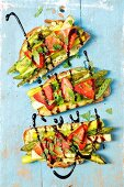 Bread with avocado spread, grilled asparagus, strawberries and balsamic glaze