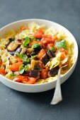 Farfalle with aubergine, tomatoes and chilli