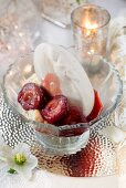 A meringue with cream and balsamic plums as a festive dessert