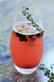 A fruity cocktail with thyme