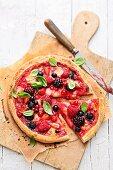 A berry pizza with mozzarella