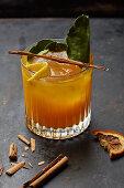 An orange drink with cinnamon