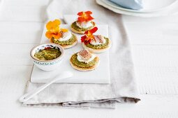 Pesto toasts topped with trout and nasturtium flowers