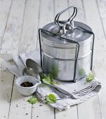 A Tiffin carrier, practical for transporting soup