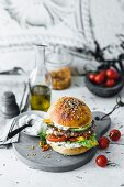 Bifteki de luxe ( a lamb burger with feta and tzatziki)