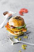 A burger with a falafel patty and sesame sauce