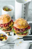 Veggie burgers with cheese patties, grilled vegetables, and corn and bean salad