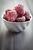 Vintage aluminium mould filled with frozen raspberries
