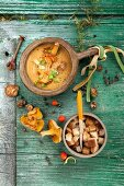 Carrot cream soup with tomatoes, crab, onion, chanterelles and croutons