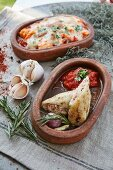 Stuffed squid and a seafood bake in serving bowls
