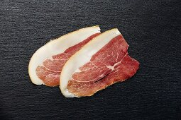 Two slices of ham on the bone from acorn-fed pigs
