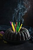A vegan gugelhupf with extinguished birthday candles
