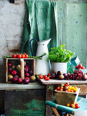 Summer harvest - tomatoes, figs, herbs grapes and plums