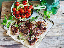 Slow-roasted tomatoes with lamb chops