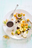 Coconut and poppy crepes with fruit and chocolate sauce