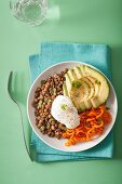 Spiralized carrot and avocado bowl with poached egg and lentil