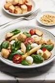 Bread salad with white asparagus, mozzarella, cherry tomatoes and basil