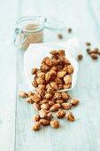 Roasted almonds in a paper cone
