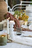 Table set with arrangement of plants and candles