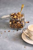 Granola with chocolate in a glass jar