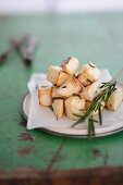 Fried celery cubes with rosemary