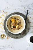 Vegan banana porridge with chocolate syrup