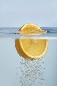 Half an orange floating in water