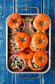 Baked tomatoes stuffed with eggplant, capers and basil