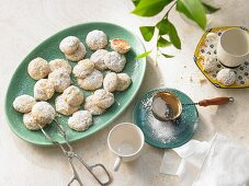 Lemon cookies with icing sugar on an oval plate