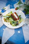 Zander terrine with tomatoes, blanched celery, and herbs, served with a cream dressing and a small salad garnish
