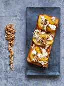 Gorgonzola with pear and walnuts on white bread