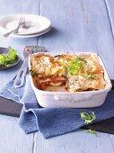 Lasagne with salsiccia, burrata and wild rocket
