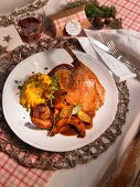 Roast goose with pumpkin wedges and puree