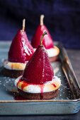 Desserts with red wine infused pears and meringue