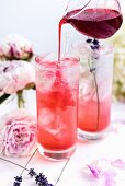 Gin and tonic with blackberry syrup