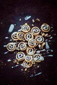 Poppy seed spiral pastries with icing