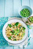 Pasta with grilled courgettes, fava beans, peas, crispy bacon and mint