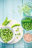 An arrangement of fresh fava beans and peas