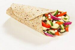 Greek salad in a whole grain wrap