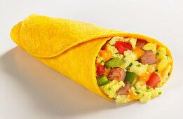 Scrambled eggs and ham in a cheese wrap