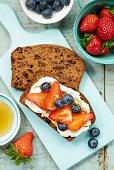 Banana bread with mascarpone, berries and honey