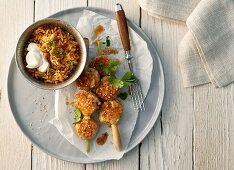 Oriental poultry balls on lemongrass skewers
