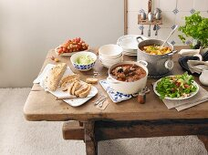 A table laid with goulash for a dinner party