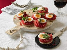 Beef tartar with boiled eggs and a mustard dip