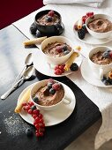 Bowls of chocolate mousse with fruit