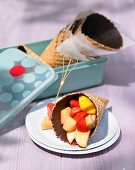 Ice cream cones with chocolate and fruit salad for a summer picnic