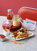 Vegetable fries, ketchup, and mayonnaise in a diner (USA)